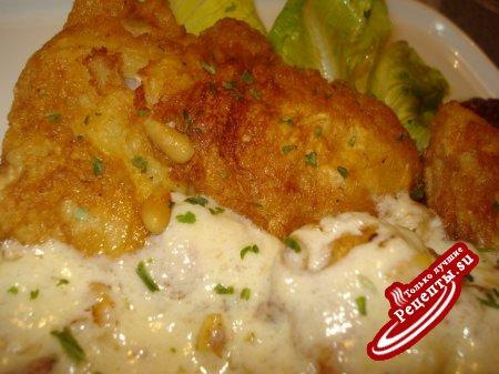 Рыба с сырным соусом и кедровыми орешками